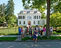 Group of individuals outside of historic home