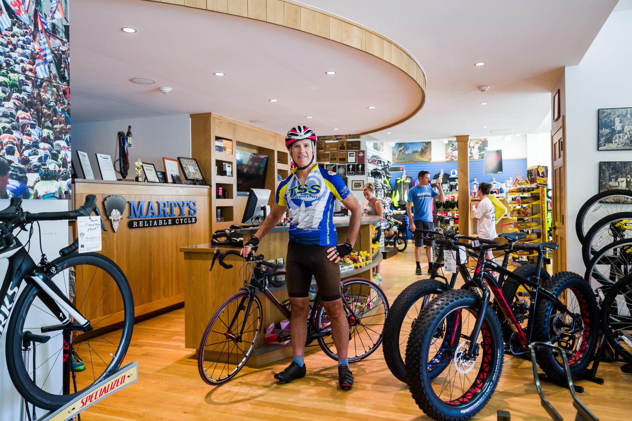 Interior shot of the Marty's Reliable Bicycles with man standing next to his bicycle.