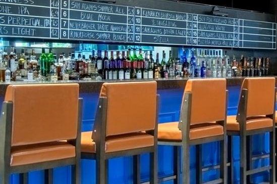 four open seats at the bar at Vanderbilt's Sports and Spirits