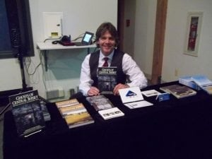 author Gordon Ward with his book