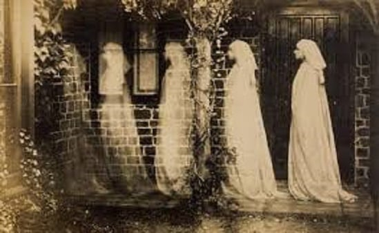 ghosts disappearing into a wall