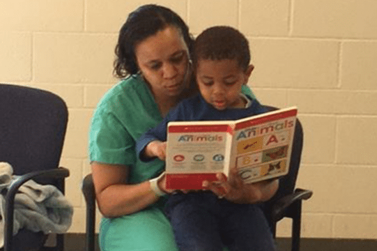 mother reading to her young son