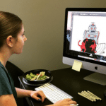 Woman creating cartoon illustrations on a computer