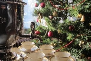 Christmas tree next to tea cups