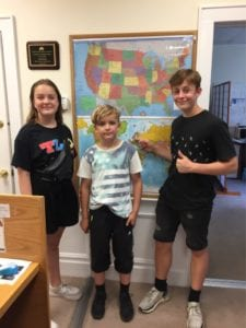 Kids in front of world map