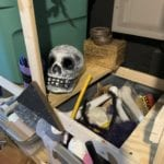 Skeleton prop on shelf behind the scenes at the Growing Stage theater