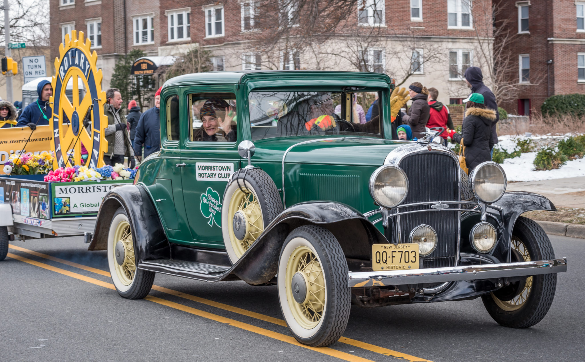 Saint Patrick's Day Parade in Morristown old fashioned green car
