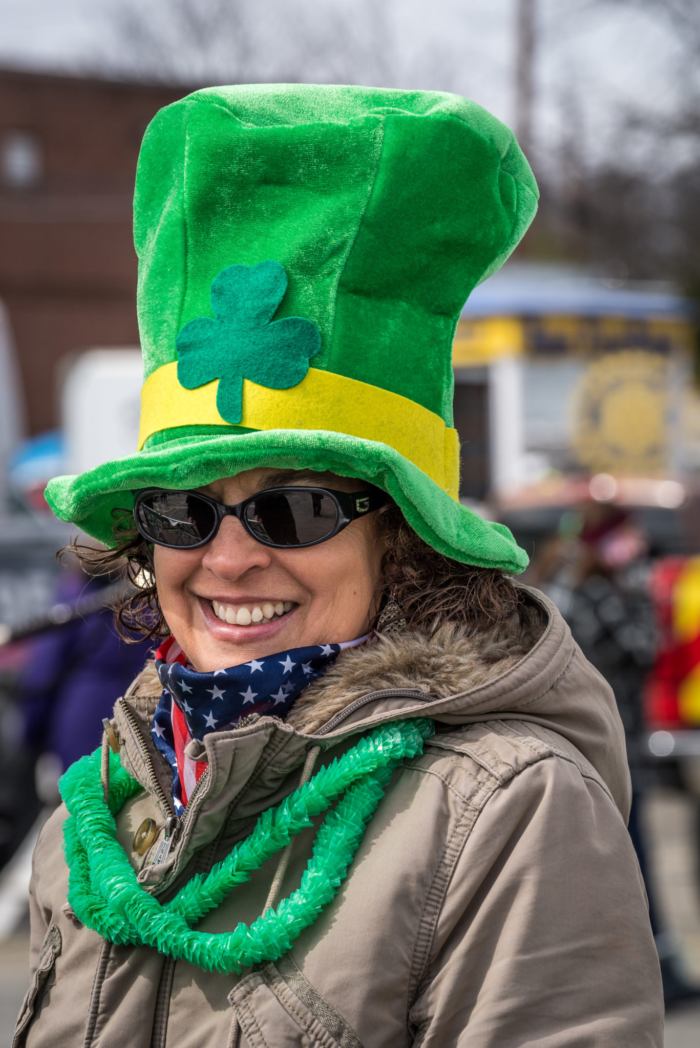 Woman at St. Patricks day parade in tall green har