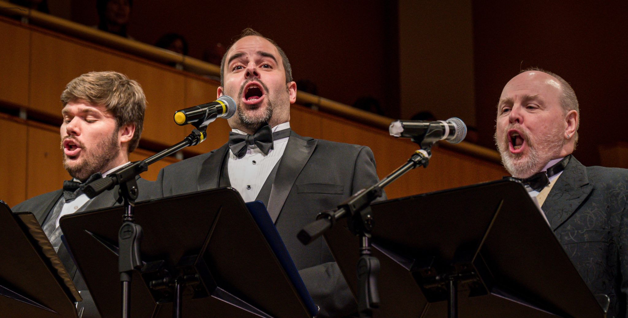 An interior view of the three tenors singing at a NJ Festival Orchestra
